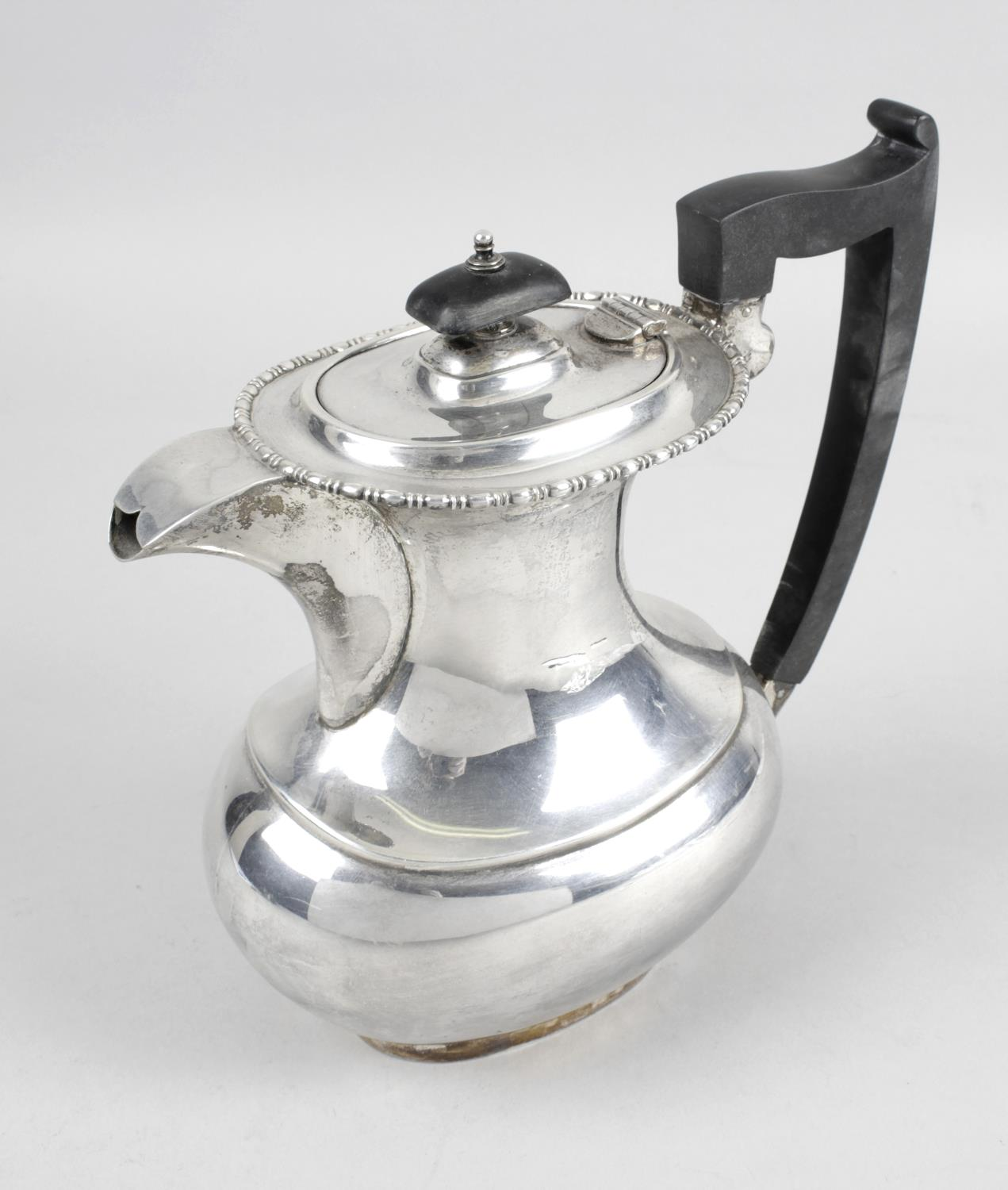 Lot 175 - A 1930's silver hot water pot,