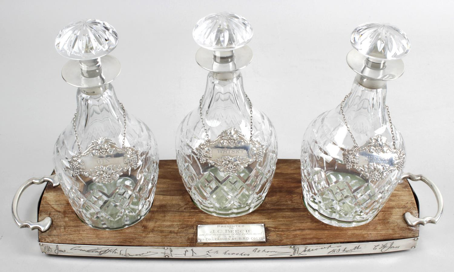 Lot 166 - A set of three mid-twentieth century silver mounted glass decanters,