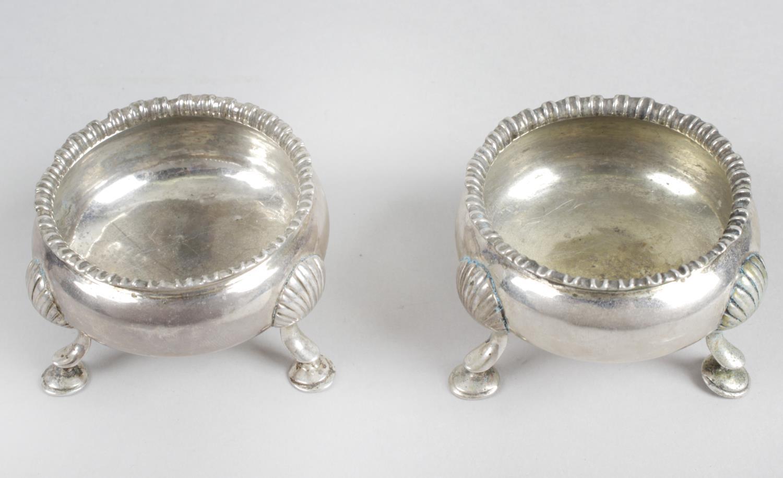 Lot 26 - A pair of George III silver cauldron salts,