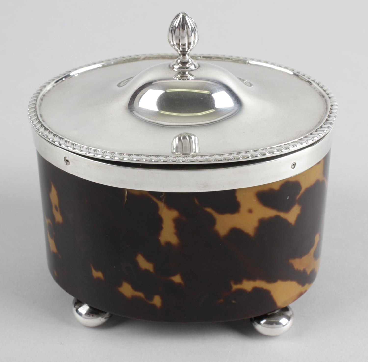 Lot 36 - An Edwardian silver mounted and tortoiseshell veneer tea caddy of oval form,