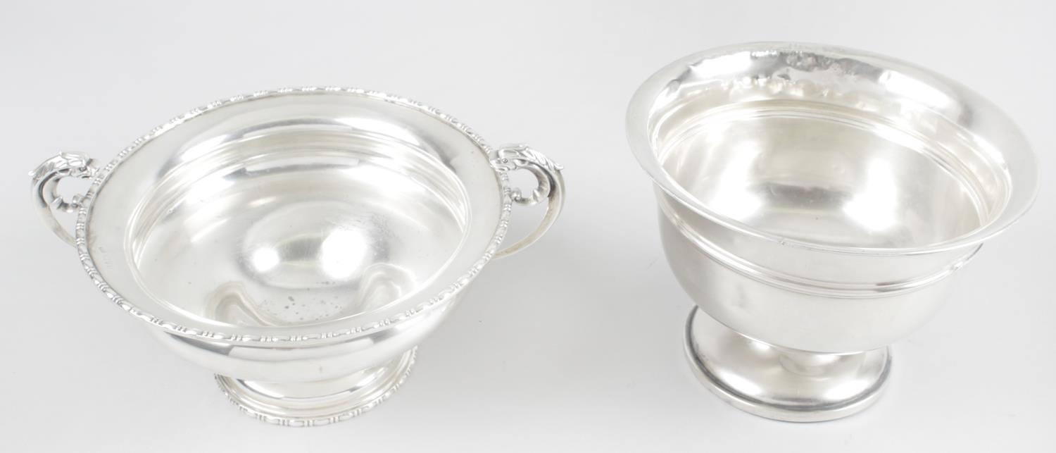 Lot 143 - A George V silver footed dish with oval bead detail to rims and twin scroll handles with zoomorphic