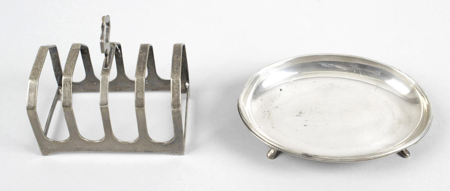Lot 104 - A 1930's small silver toast rack,