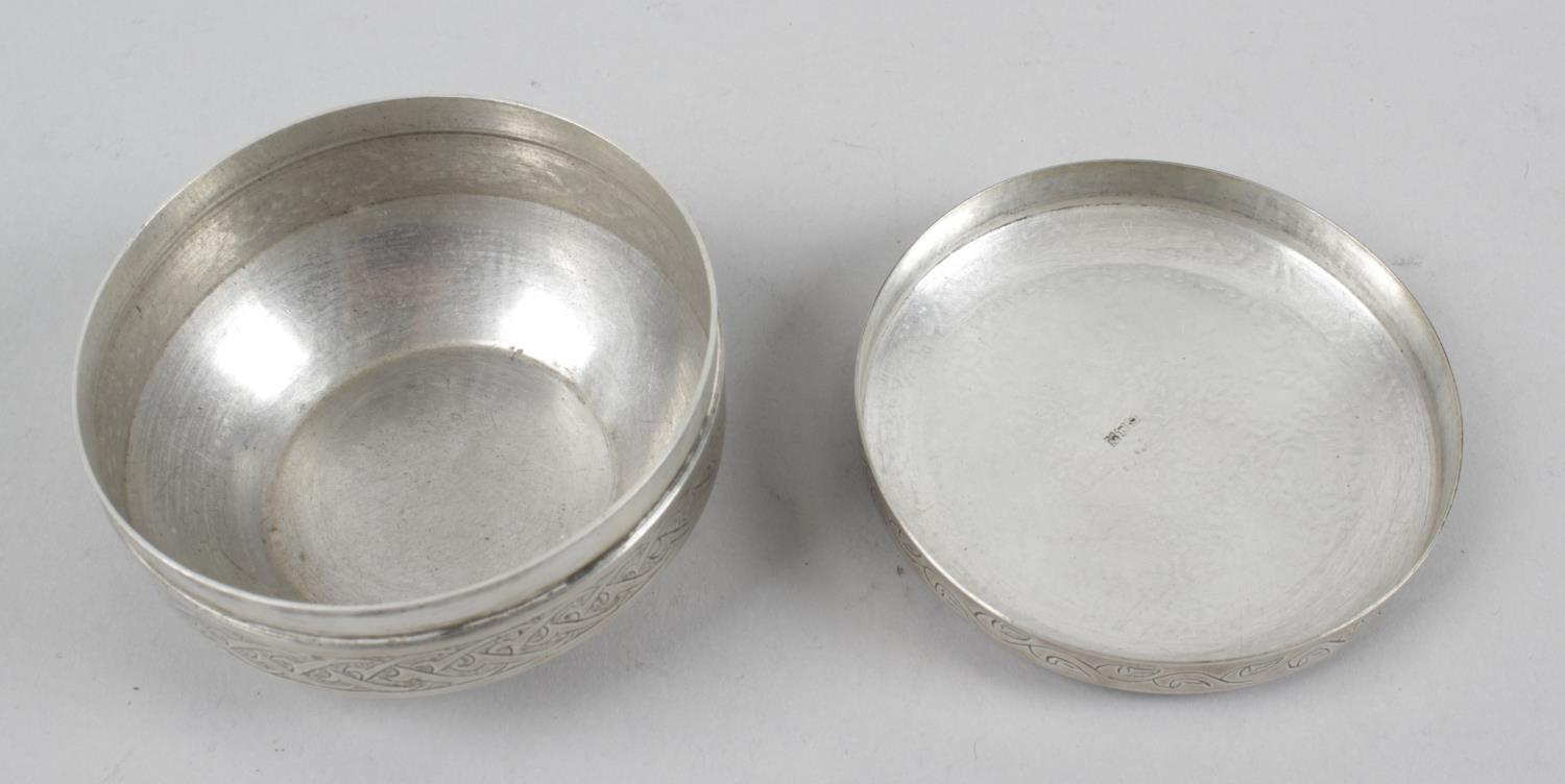 Lot 109 - An Egyptian silver lidded box of circular form,