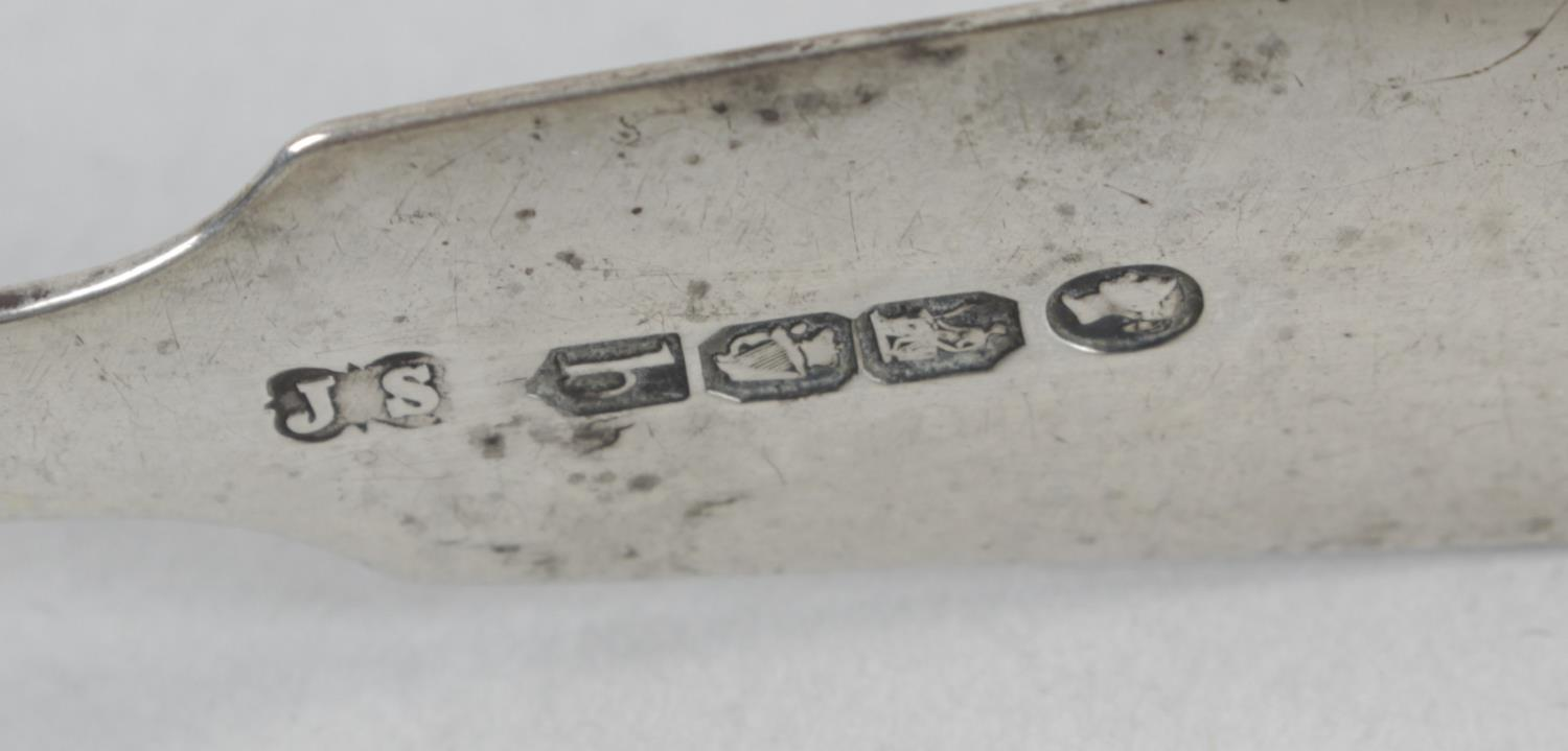 Lot 95 - A pair of William IV silver sugar tongs,