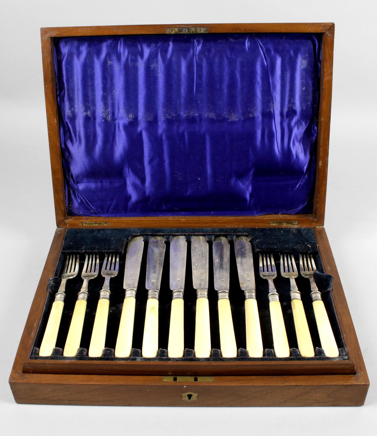 Lot 23 - A cased set of Edwardian silver and ivory-handled fish knives and forks for six place settings,
