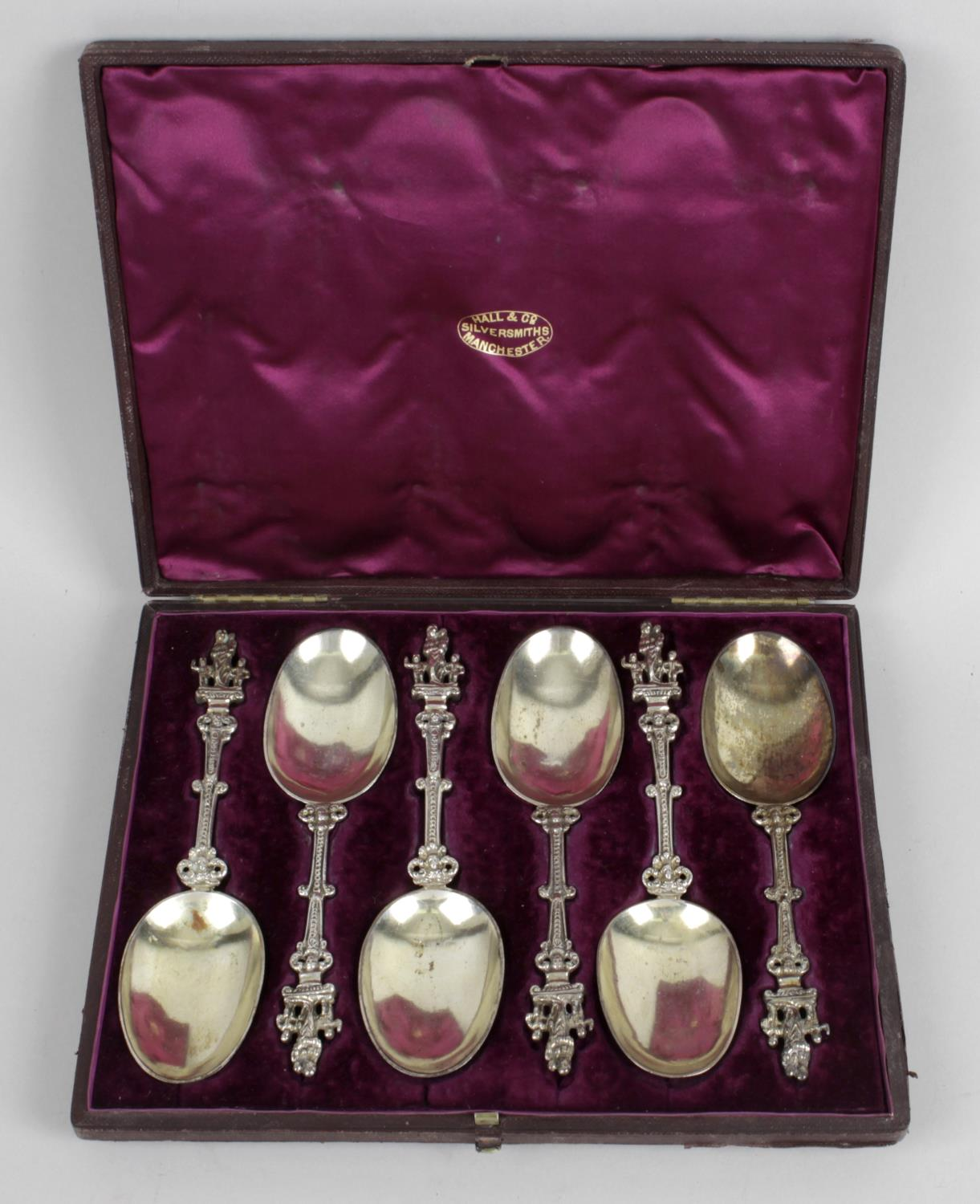 Lot 167 - A cased set of six continental silver spoons,