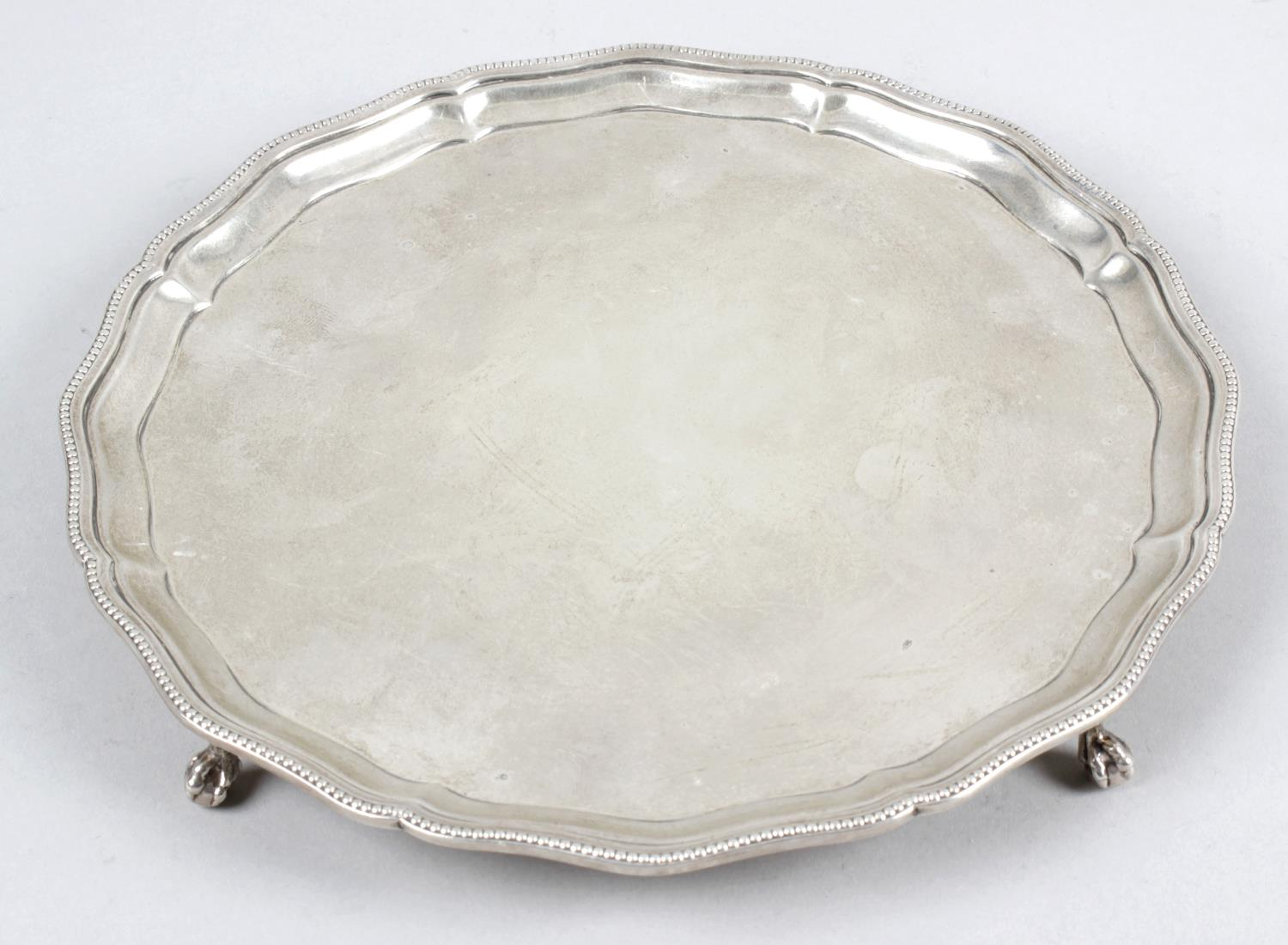 Lot 47 - A 1930's small silver salver,