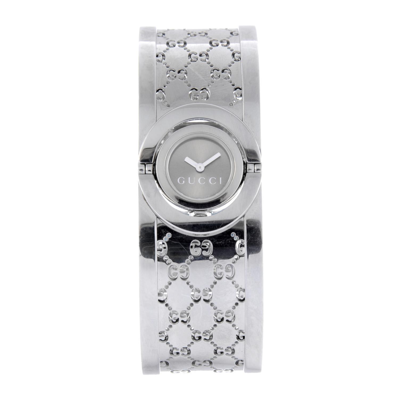 Lot 53 - GUCCI - a lady's Twirl bangle watch.