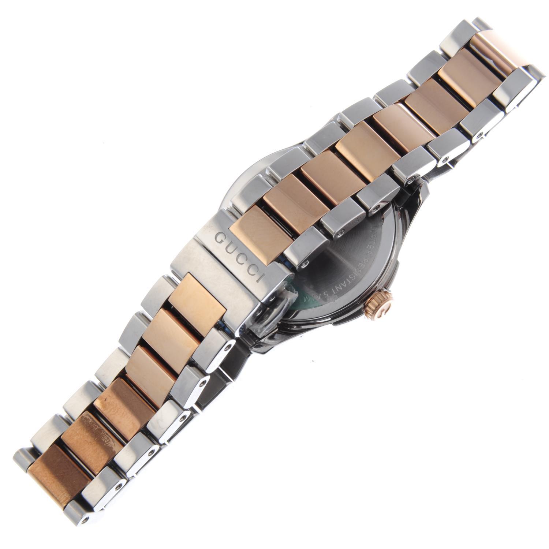 Lot 59 - GUCCI - a lady's G-Timeless bracelet watch.