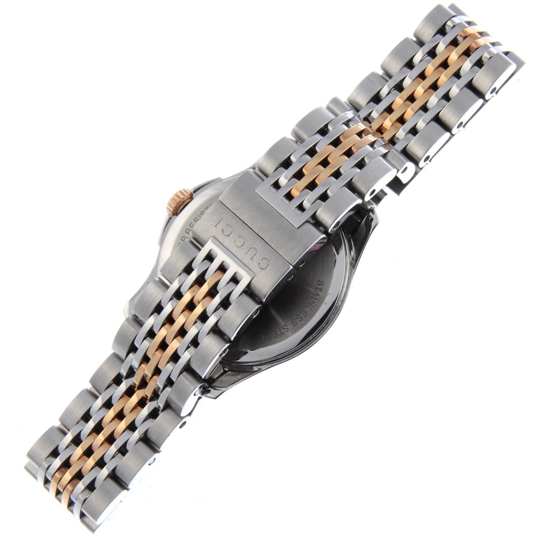 Lot 51 - GUCCI - a lady's G-Timeless bracelet watch.