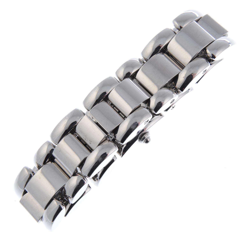 Lot 14 - CHAUMET - a lady's Milhewi bracelet watch.