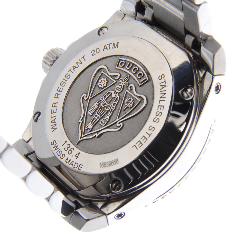 Lot 49 - GUCCI - a lady's Dive bracelet watch.