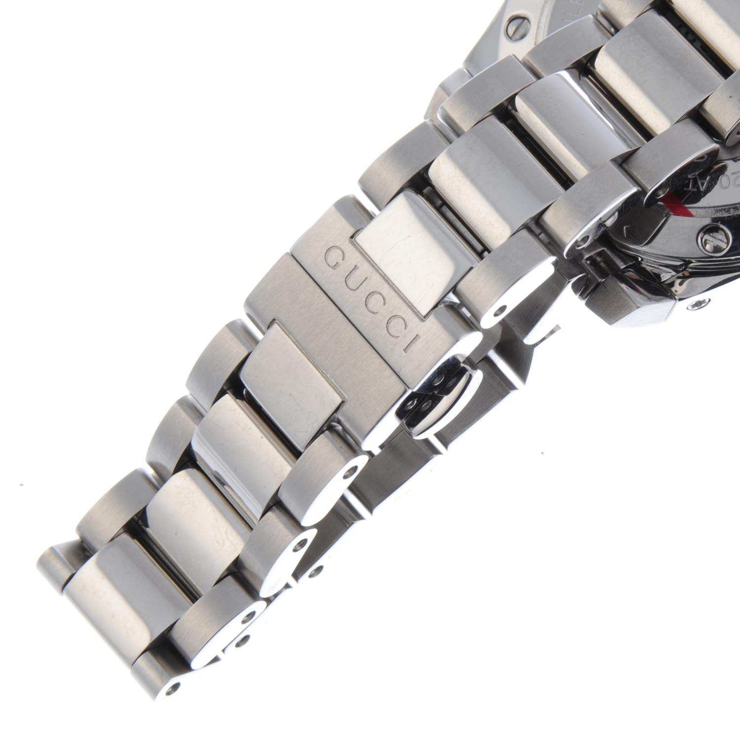 Lot 52 - GUCCI - a lady's Dive bracelet watch.