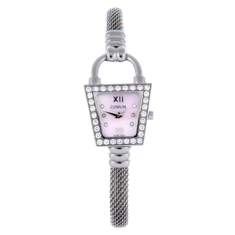 Lot 17 - CORUM - a lady's Padlock Trapeze bracelet watch.