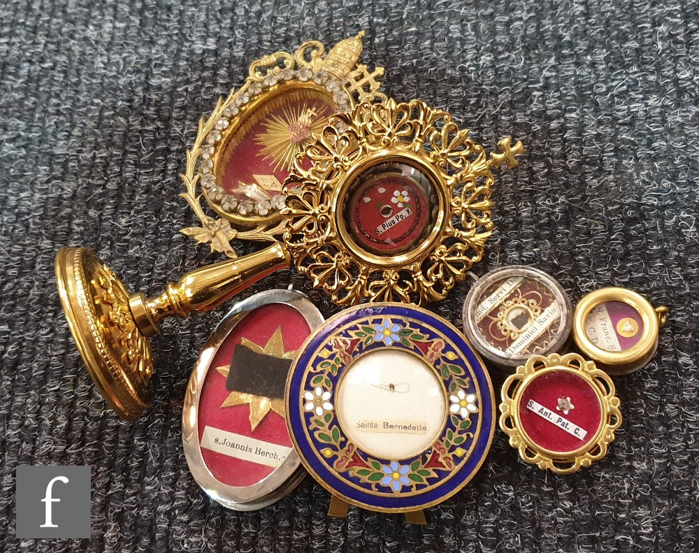 Lot 701 - A Reliquary of Sainta Bernadette in 20th Century circular champ leve frame, another in paste oval