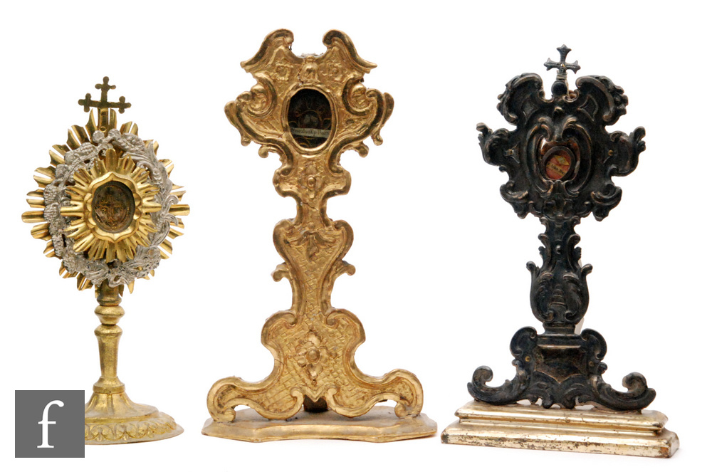 Lot 700 - A Reliquary of St Nicoalus Ep.Barien in a 19th Century carved giltwood stand, height 25cm, another