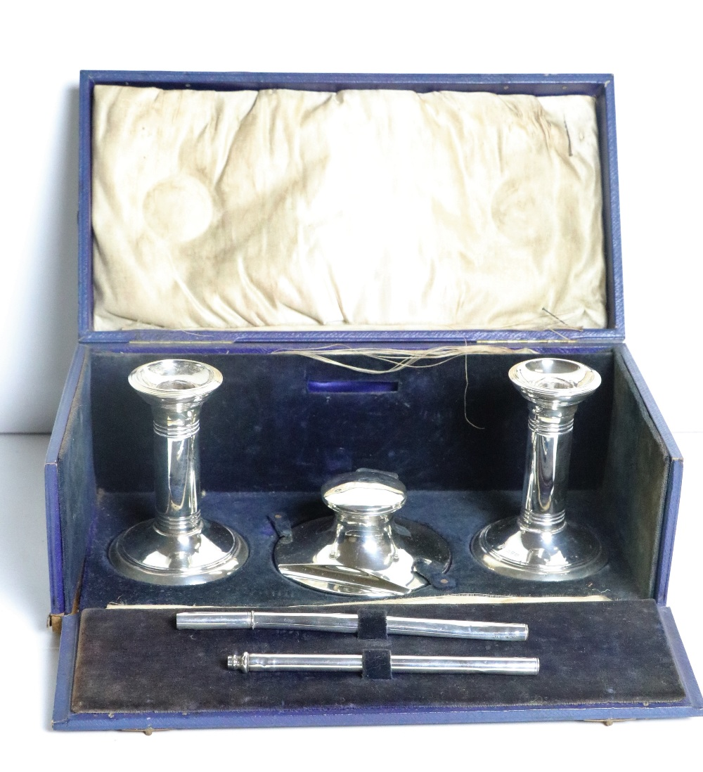 Lot 53 - A Victorian silver Stationery Set, in original box, comprising inkwell, two candlesticks and pen.
