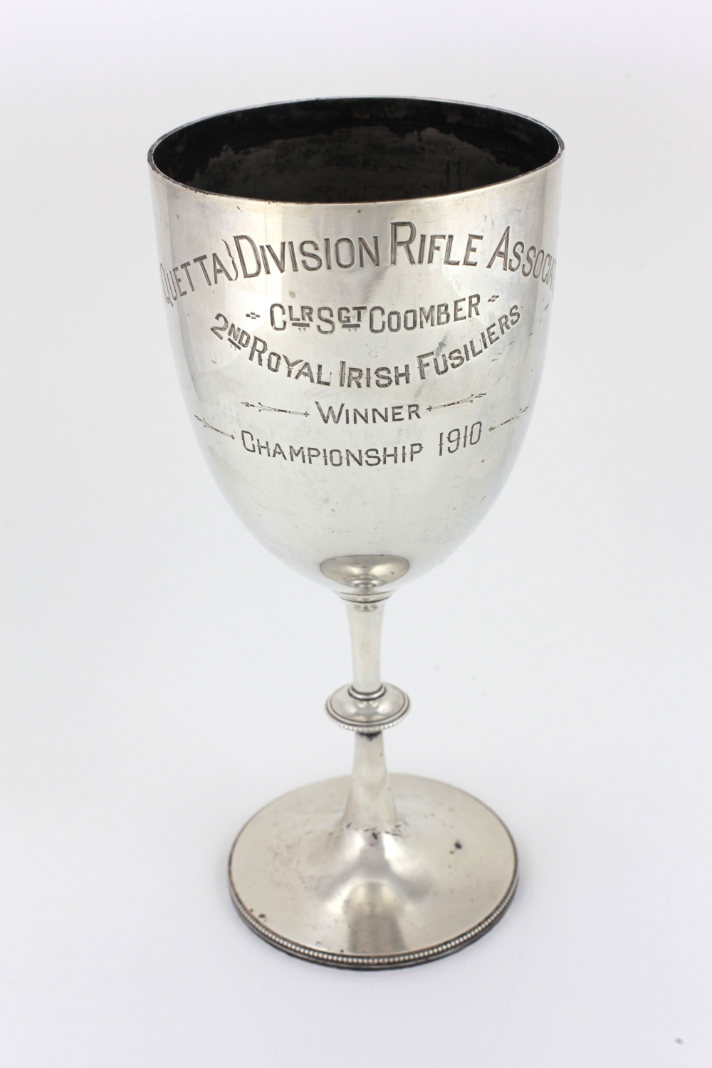 "Lot 32 - A tall English silver Trophy Cup, London c. 1909, inscribed ""4th Ouetta Division Rifle Association."