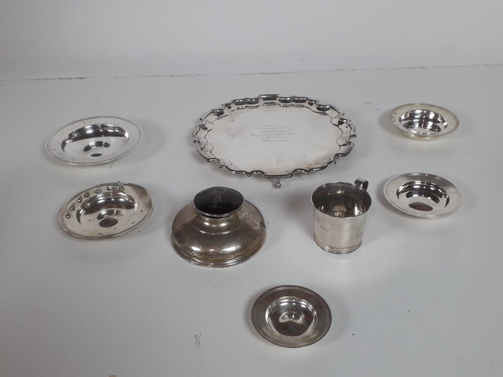 Lot 39 - A modern Sheffield silver Salver, with moulded rim on three scroll feet, c. 2000, approx.