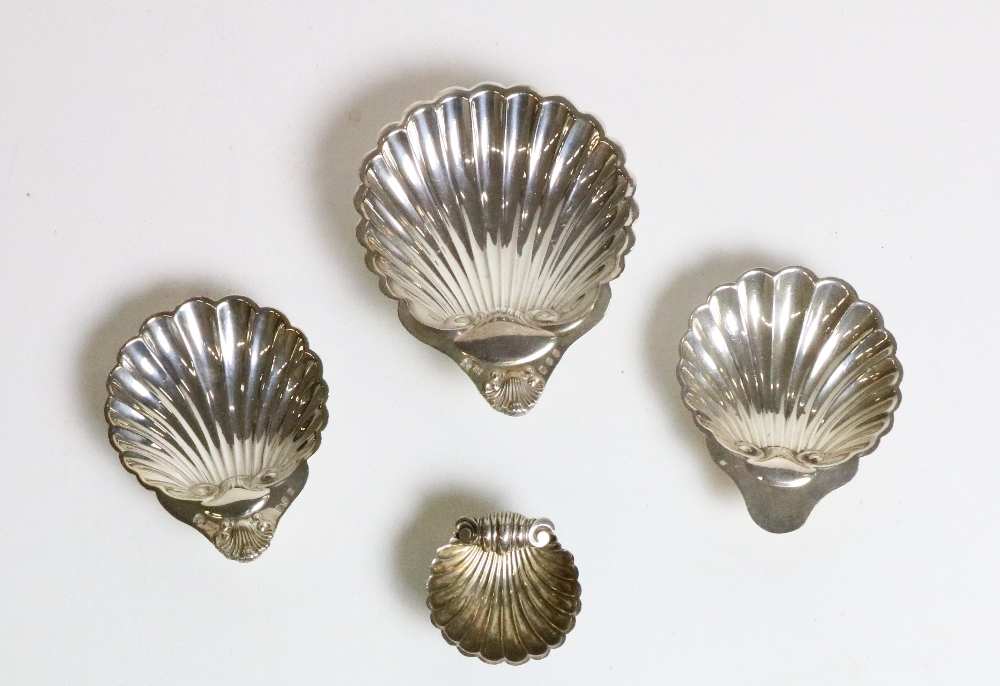 Lot 43 - A set of 4 silver graduating shell design Dishes, approx. 7 ozs.