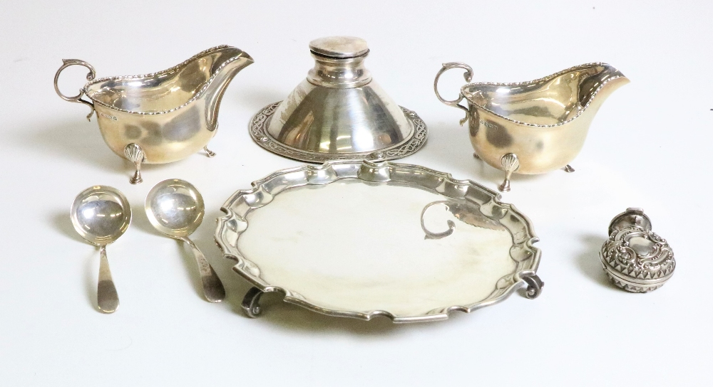 Lot 40 - Silverware: A pair of attractive silver Sauceboats with scroll handles on pad feet;