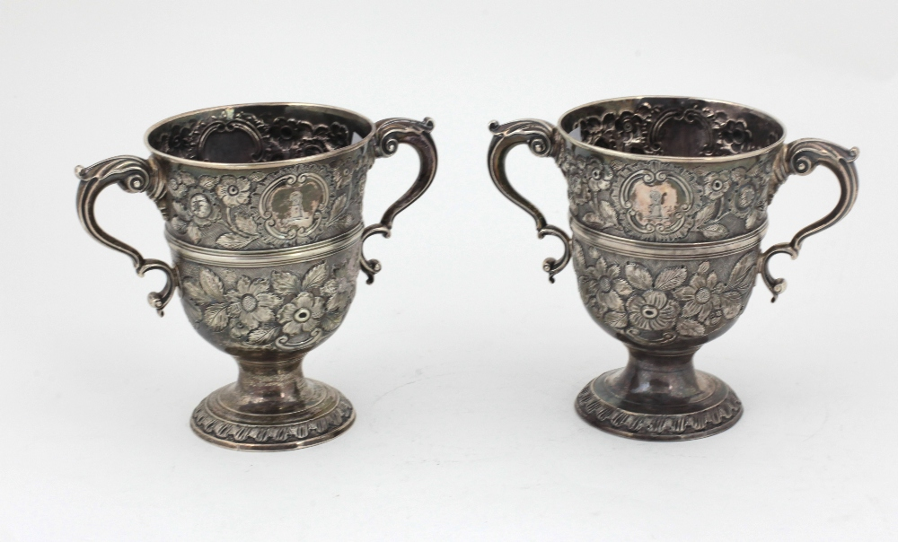 Lot 18 - A fine quality and heavy pair of 18th Century English silver two handled Cups,