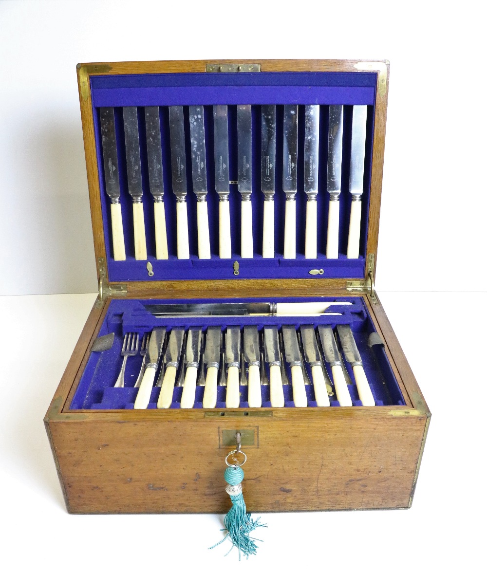 Lot 10 - An oak cased and brass bound Canteen of Cutlery, by J.