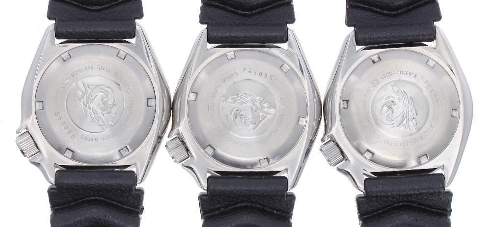Lot 1876 - Three Seiko Divers stainless steel gentleman's wristwatches, ref. 7002-7000, each with custom