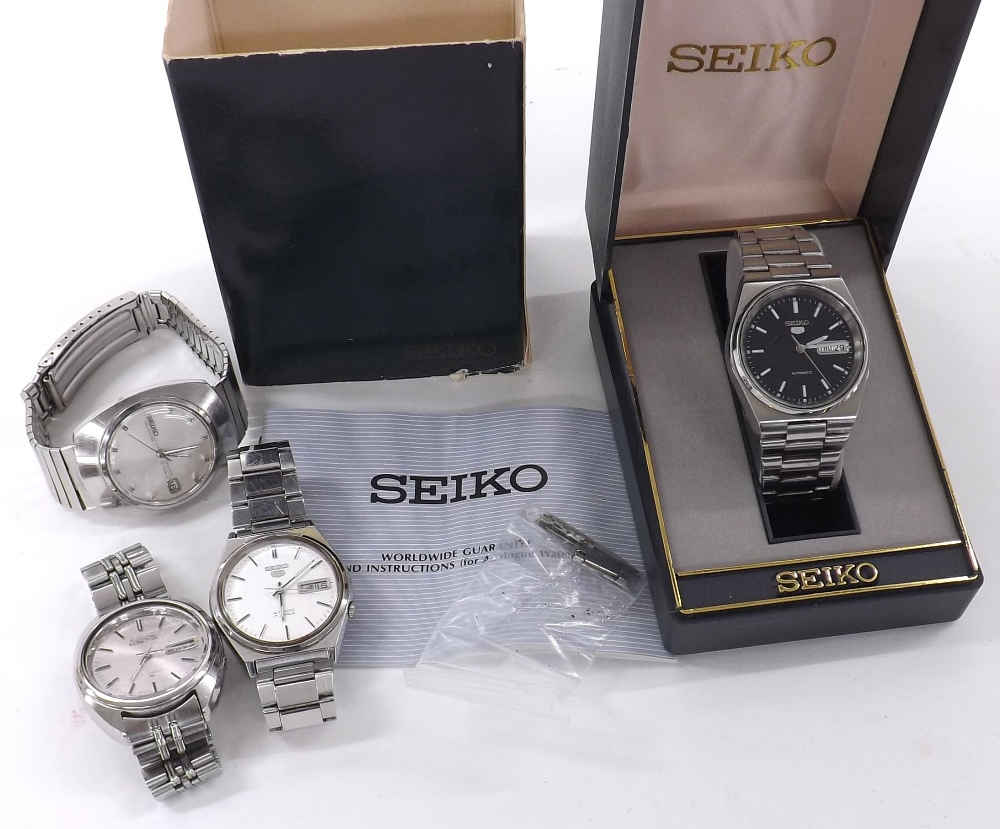 Lot 1871 - Two Seiko 5 automatic stainless steel gentlemen's bracelet watches; together with a Seiko