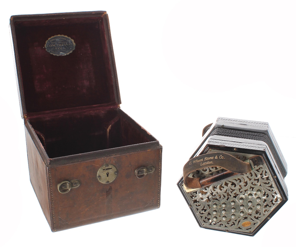 Lot 1217 - C. Wheatstone *Linota* Anglo concertina, with thirty-seven buttons on foliate pierced metal ends,