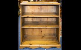 Two Pine Bookshelves comprising tall uni
