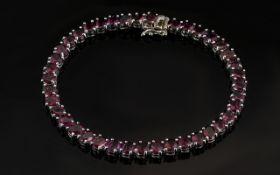 Garnet Tennis Bracelet, oval cuts of the