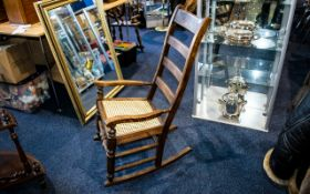 Rocking Chair Of plain form with caned s