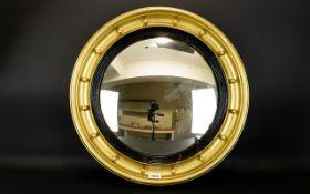 A Circular Porthole Mirror Convex mirror circa early-mid 20th century in pale gilt frame,