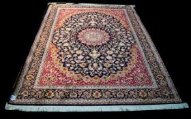 A Very Large Woven Silk Carpet Keshan rug with midnight blue ground and traditional Middle Eastern