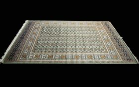 A Very Large Woven Silk Bokhara Carpet Ornate silk carpet with traditional lozenge and geometric
