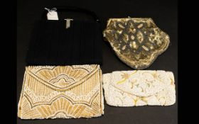 A Collection Of Vintage Evening Bags Four in total to include black crepe 1930's top clasp bag with