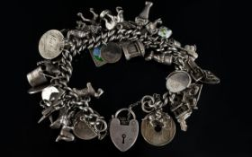 Antique Curb Silver Bracelet Loaded with 40 Silver Vintage Charms, All Marked for Silver,