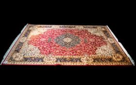 A Very Large Woven Silk Carpet Keshan rug with red ground and traditional Middle Eastern floral and