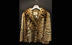 Ocelot Hip Length Jacket Size 10/12.