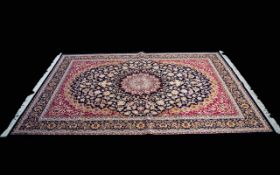 A Very Large Woven Silk Carpet Keshan rug with cobalt blue ground and traditional Middle Eastern