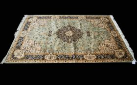A Large Woven Silk Carpet Keshan rug with Eau De Nil ground and traditional Middle Eastern floral