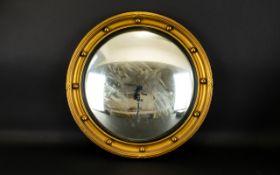 A Circular Porthole Mirror Convex mirror circa 1950's in yellow gilt frame, diameter 17 inches.