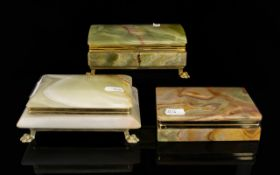 Three Brass Mounted Onyx Cigarette Boxes Each of rectangular form, each in good condition,