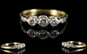 18ct Gold and Platinum Diamond Set 3 Stone Dress Ring. c.1920's.