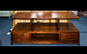 A Stained Beechwood Television Stand Two tier low table with two drawers and four apertures.
