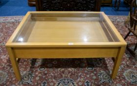 Contemporary Glass Topped Coffee Table Beech effect table with integral drawer and glass top.