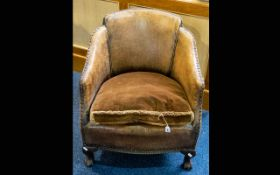 An Early 20th Century Brown Leather Tub Chair Of small proportions with drop in seat,