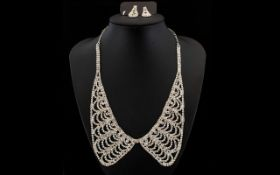 White Crystal Collar Necklace and Matching Drop Earrings, a filigree collar style necklace with