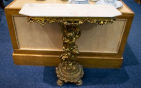 Reproduction Italian Style Figural Console Table Gilt support with putti figure and reconstituted